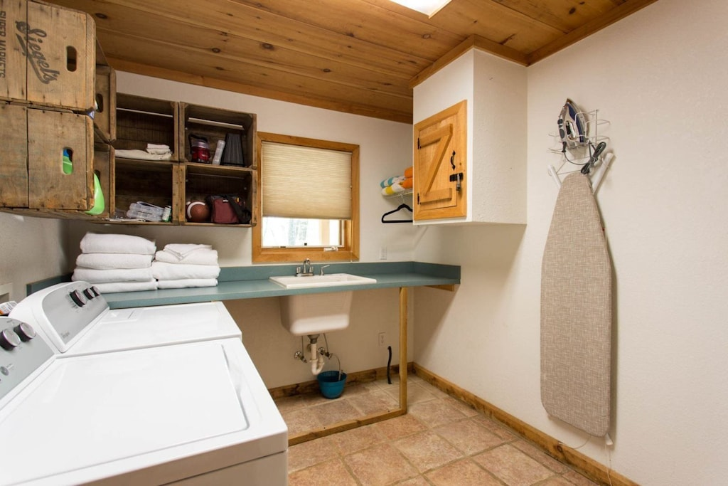 The laundry room has a full-size washer/dryer, sink, ironing board, and makes unique use of old crates.