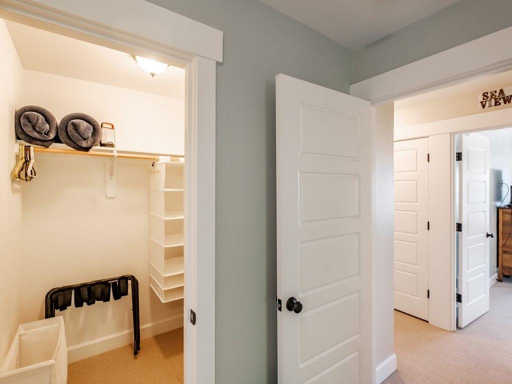 Large walk in closet off the twin Juliette bedroom.