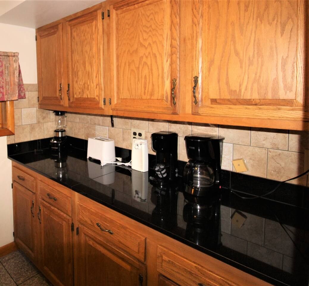Granite countertops, tiled backsplash and all the kitchen appliances you'll need for a comfortable stay