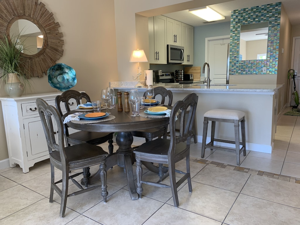 Table for 4 and 3 barstools make it easy for everyone!