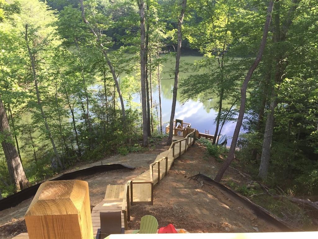 Walk down the illuminated stairs to enjoy the lake