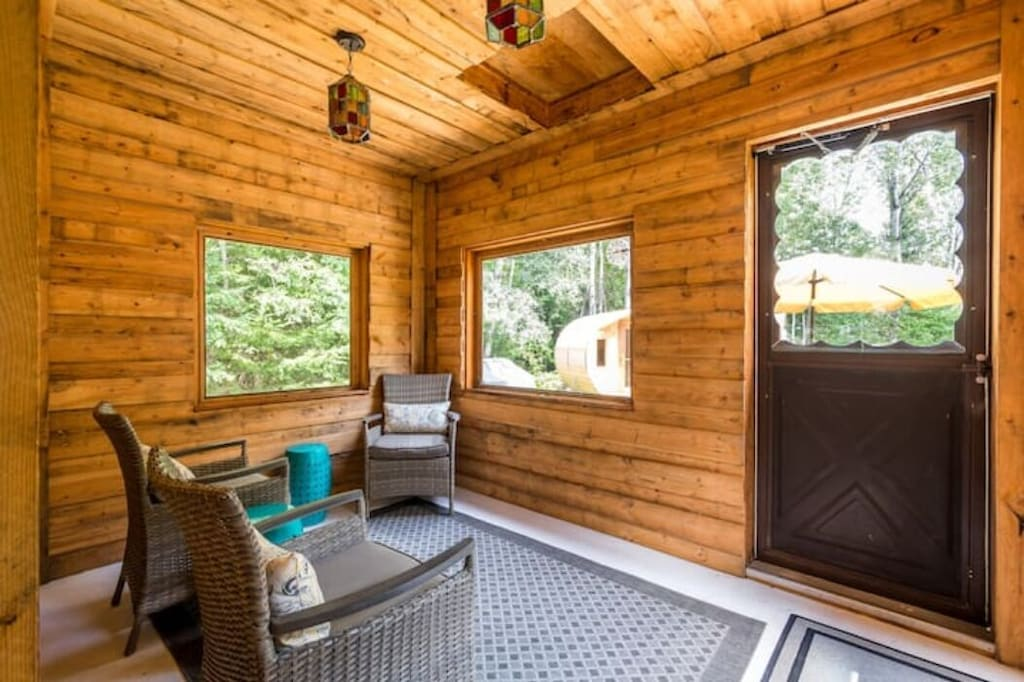 Muskoka Room in rear of cottage with screens so no bugs