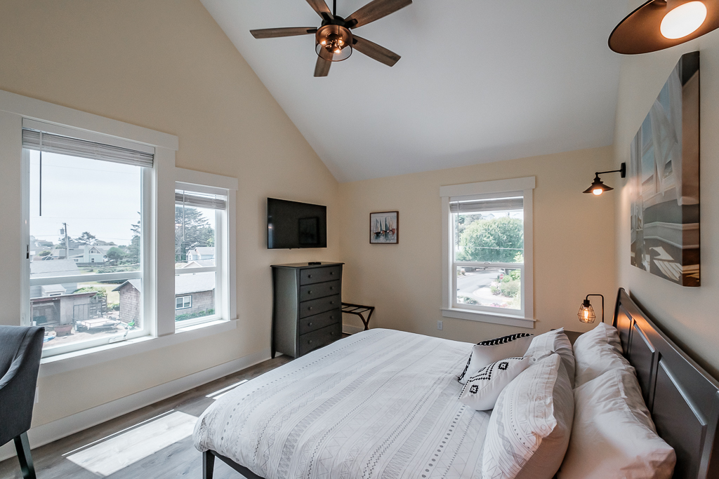 Second-floor bedroom include en-suite, workspace, Smart TV, and plenty of storage for clothes and personal effects.