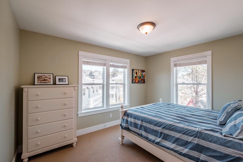 Park side bedroom with nice lighting.