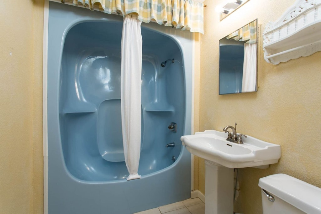 It also has an adjoining private bath.