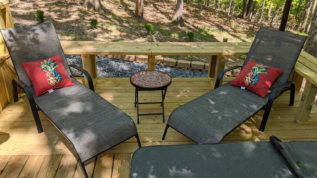 Lounge chairs on all sides of hot tub and on both deck levels