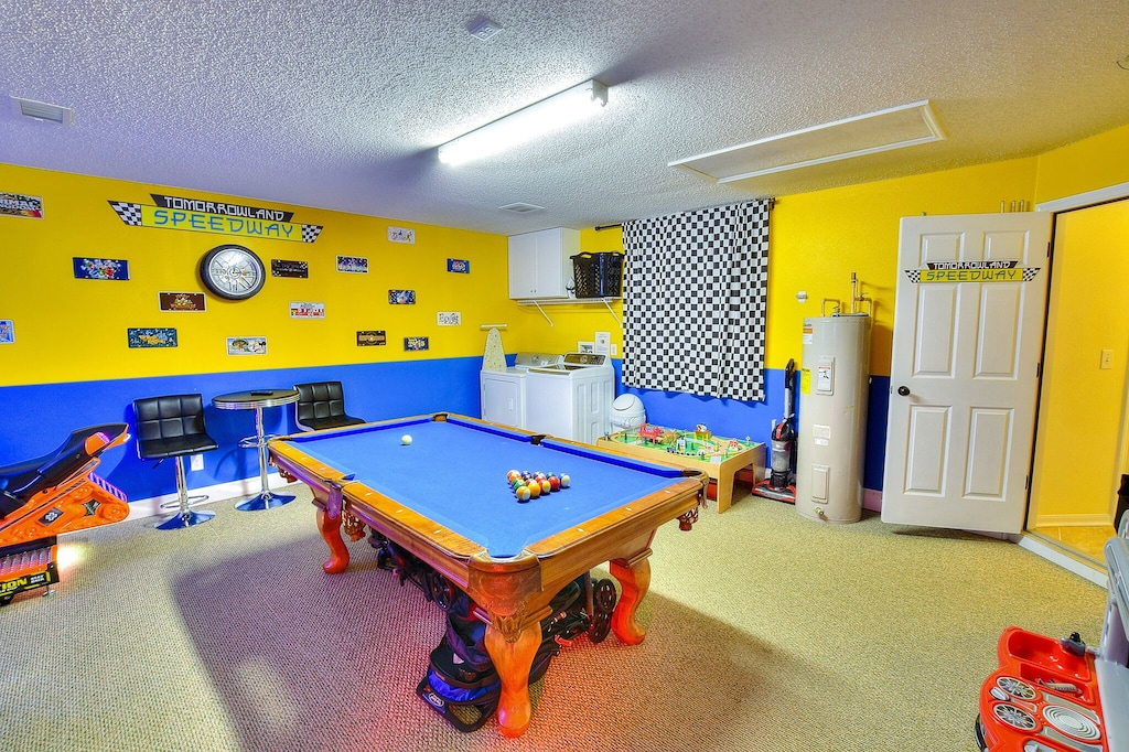 The pool table and laundry units.