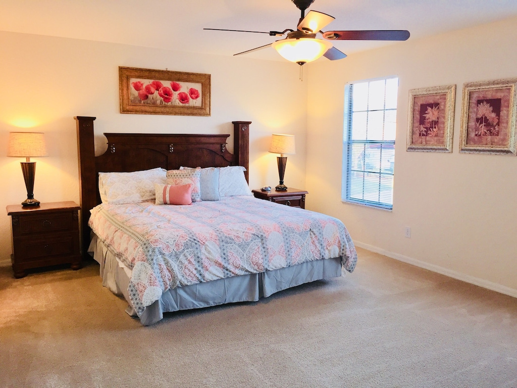 King master bedroom with large smart TV