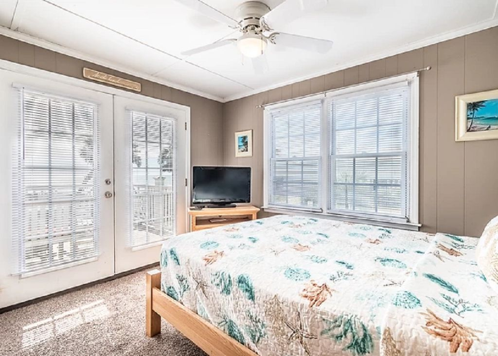 Guest Bedroom 3 with queen and tv and ocean views!