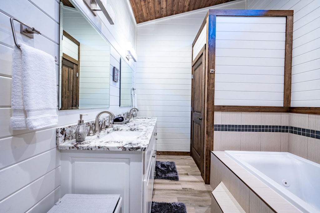 jacuzzi tub with separate walk-in shower in master bath
