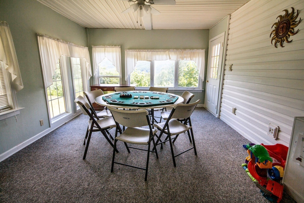Another game room for card games adjacent to living and dining rooms