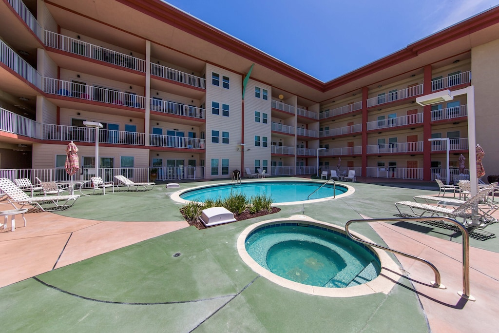 Huge patio pool and hot tub area is right out your front door and has ocean view