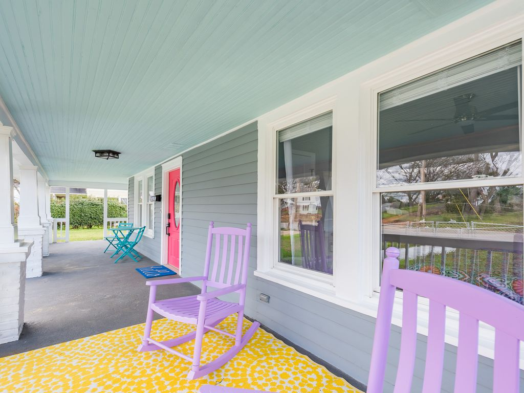 Large wrap around porch with southern sky inspired ceiling.