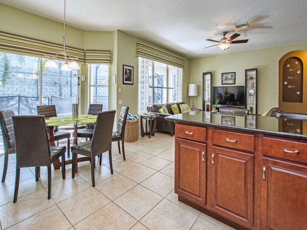 Kitchen has view of family room and pool area.