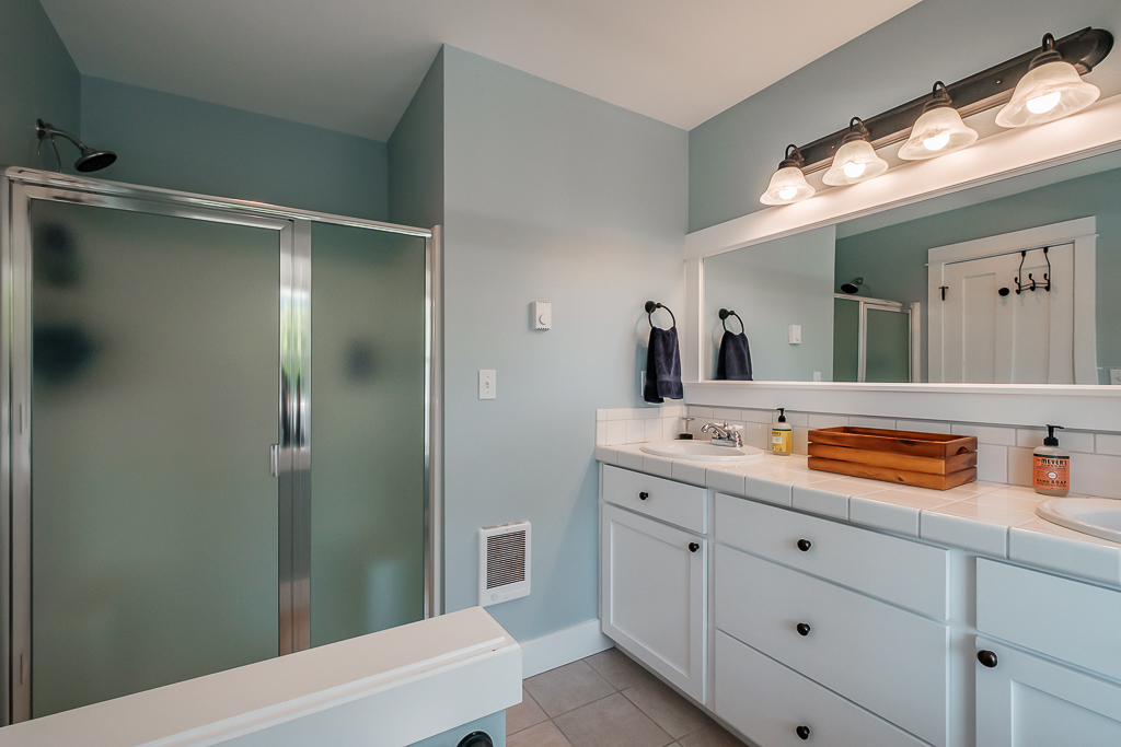 En suite with shower and double vanity.