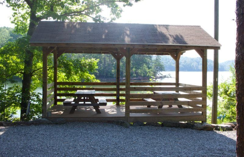 Enjoy a family picnic by the lake under the covered area