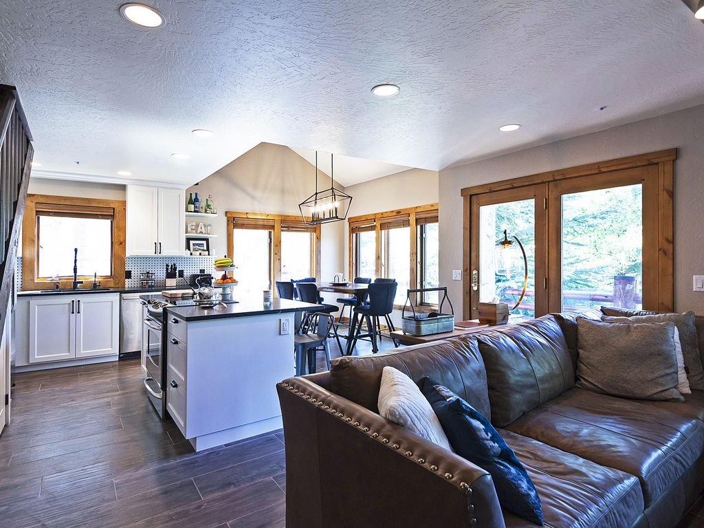 Open living area to dining, kitchen, private deck looking at DV Resort