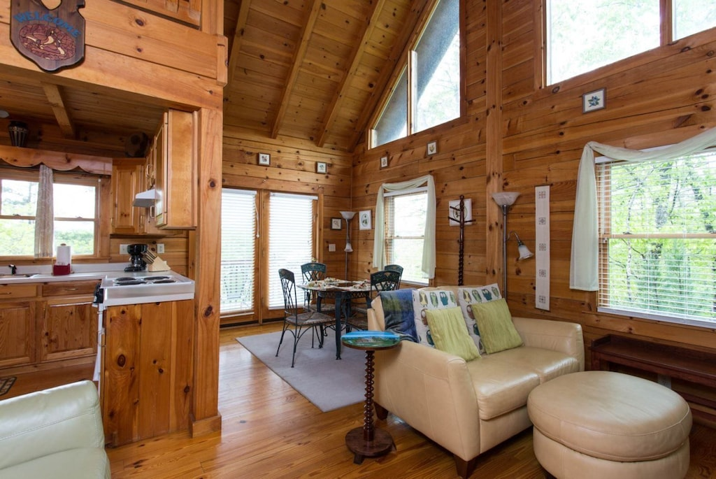 There are plenty of windows and French doors, behind the dining table, lead to the deck.