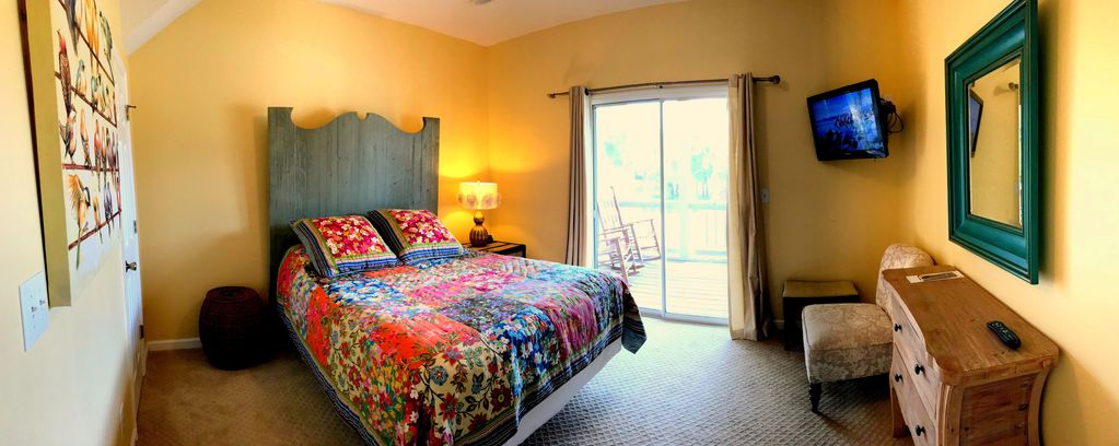 This bedroom offers a flat screen tv & private entrance to screened porch also.