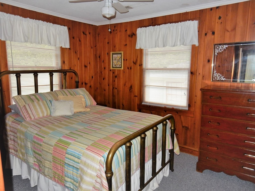On the upper or street level of the home are 4 bedrooms. This first bedroom has a full bed.