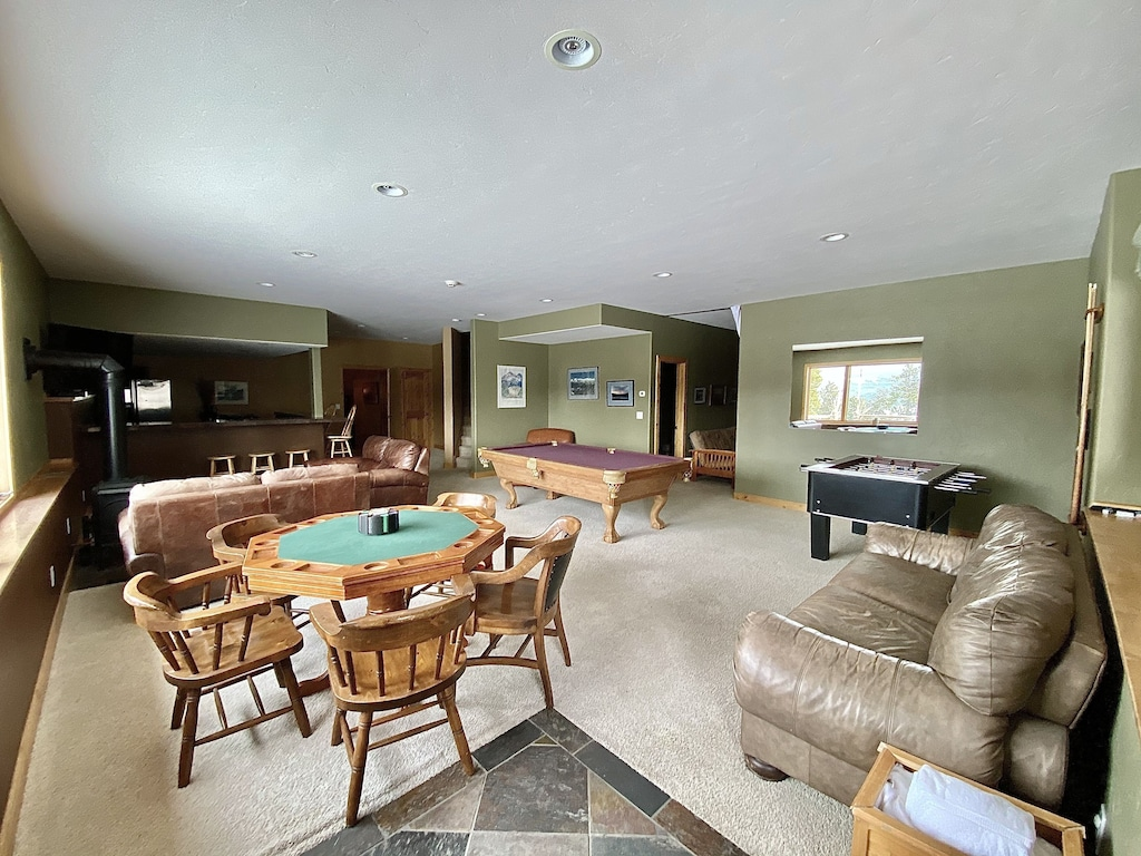 Game Room - Pool table, poker table, foosball table, bar, and hi-def tv multiple couches. Hot tub is right outside