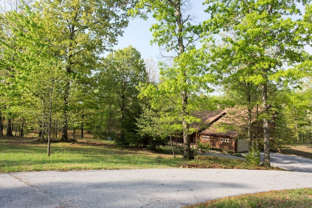 There is also a paved drive and paved roads in the community, this home is perfect for bikes and motorcycles.