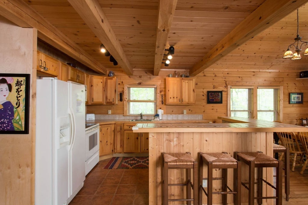 The kitchen is fully equipped. The side-by-side refrigerator has an in-door water/ice dispenser.