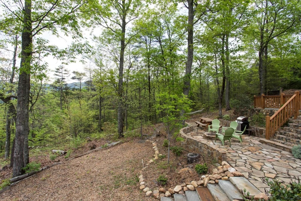 Stairs lead to the sloping back yard.