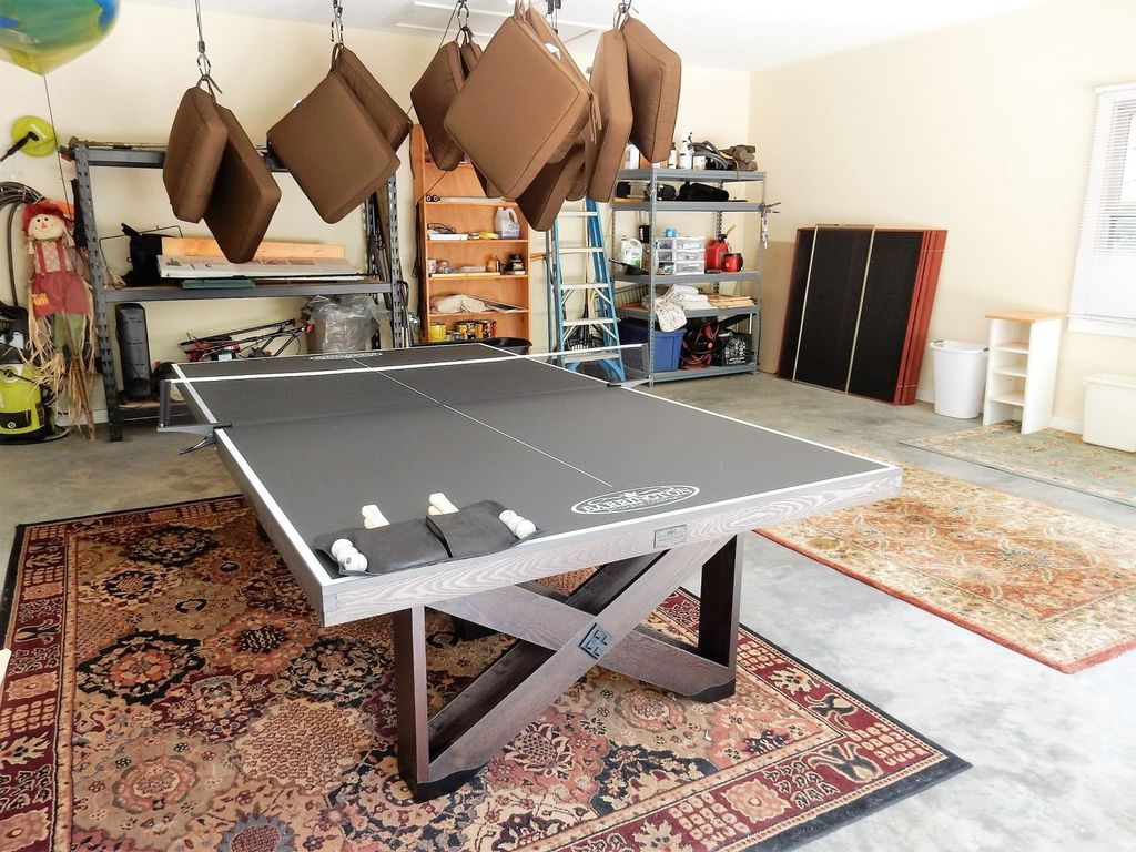 Ping pong table in the garage, corn hole game and more!