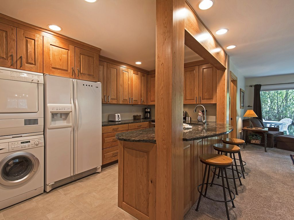 Remodeled kitchen with built in washer/dryer