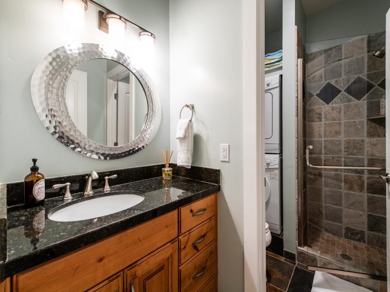 Bathroom 3. Laundry machines, walk in shower, separate vanity area.