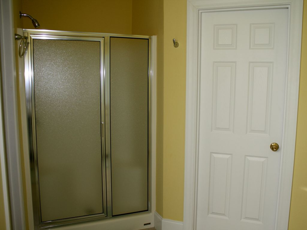 both upstairs and downstair master baths have separate showers