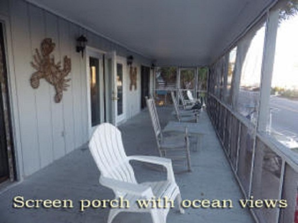 Screened in porch with views of the beach and ocean!