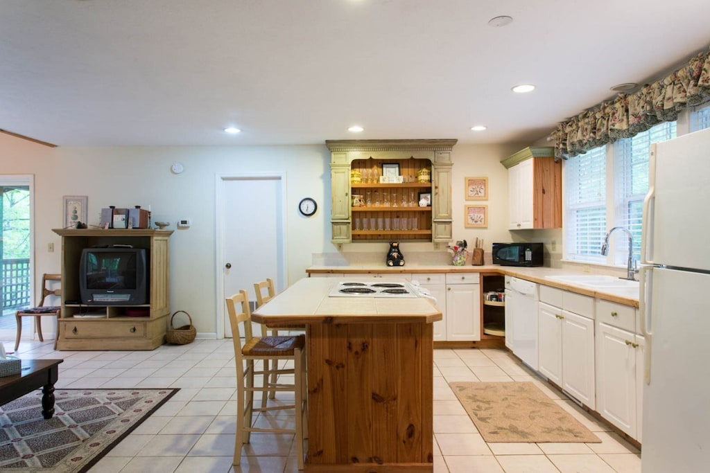 The kitchen is fully equipped with all of the necessary appliances including a dishwasher.
