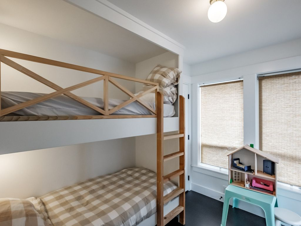 Bunk room opens from the upper hallway and from a barn door slider off of fourth bedroom.