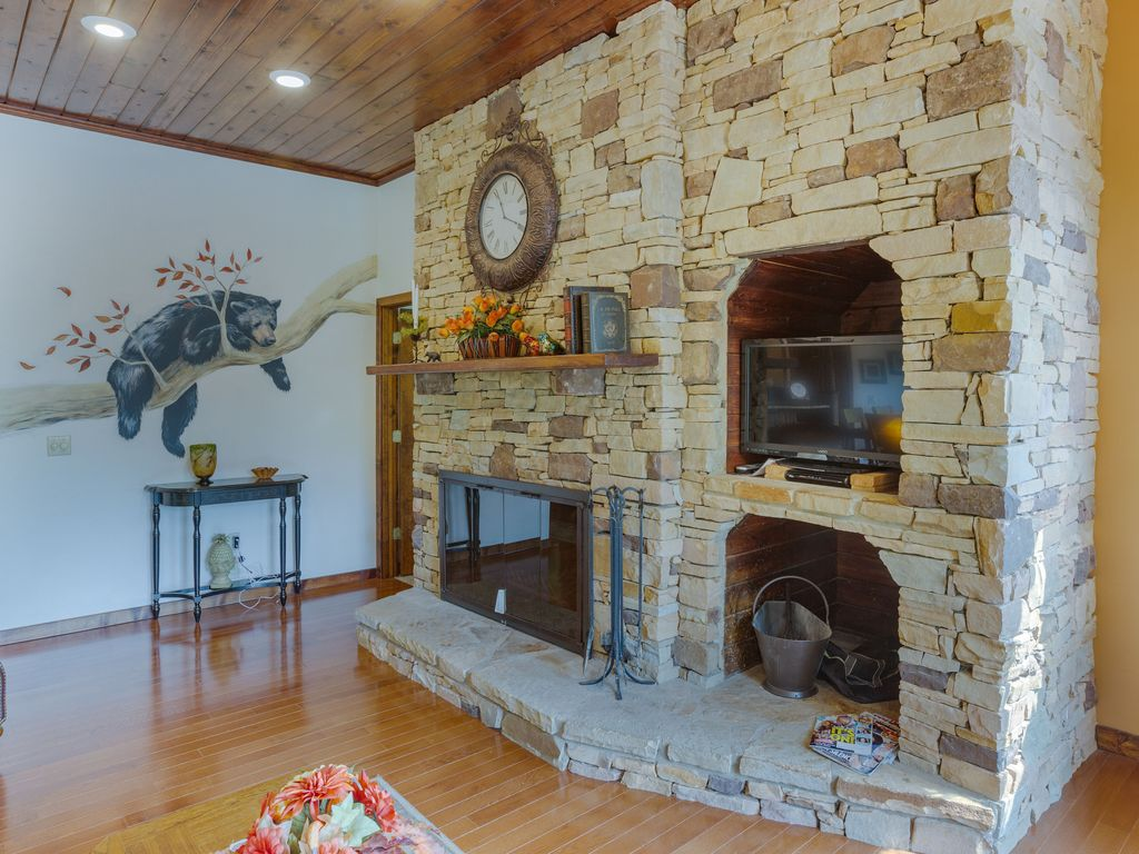 2nd floor wood burning fireplace in living room. Wood supplied in winter.