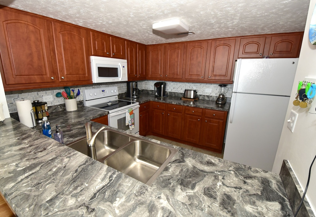 Enjoy Our Kitchen With Its Ocean Views & New Appliances/Supplies Just Like Home.