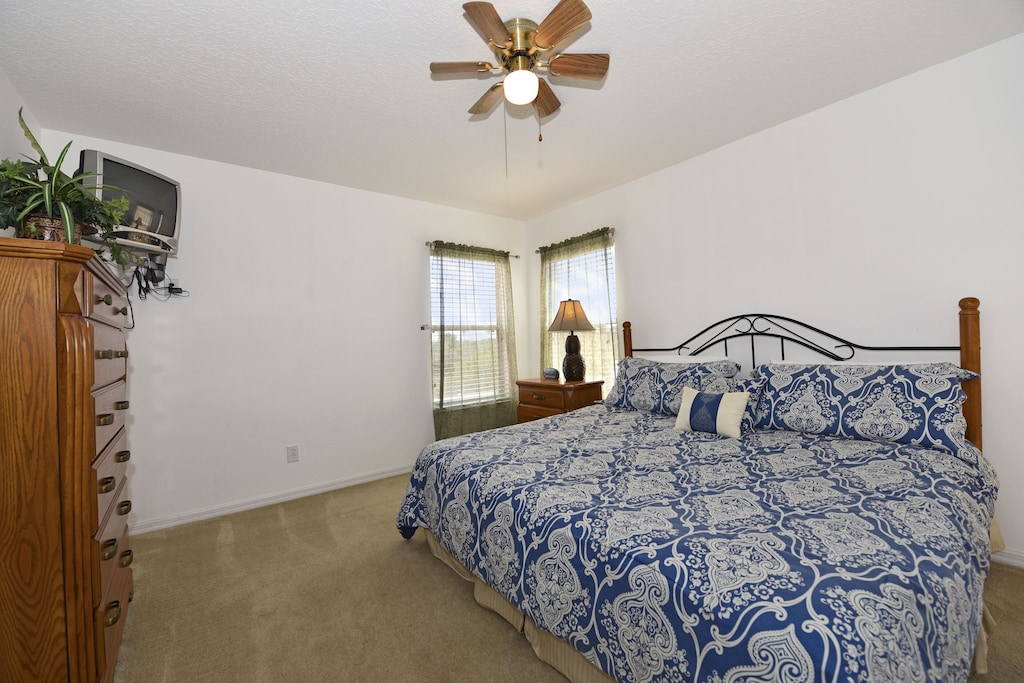 master bedroom upstairs with flat screen TV