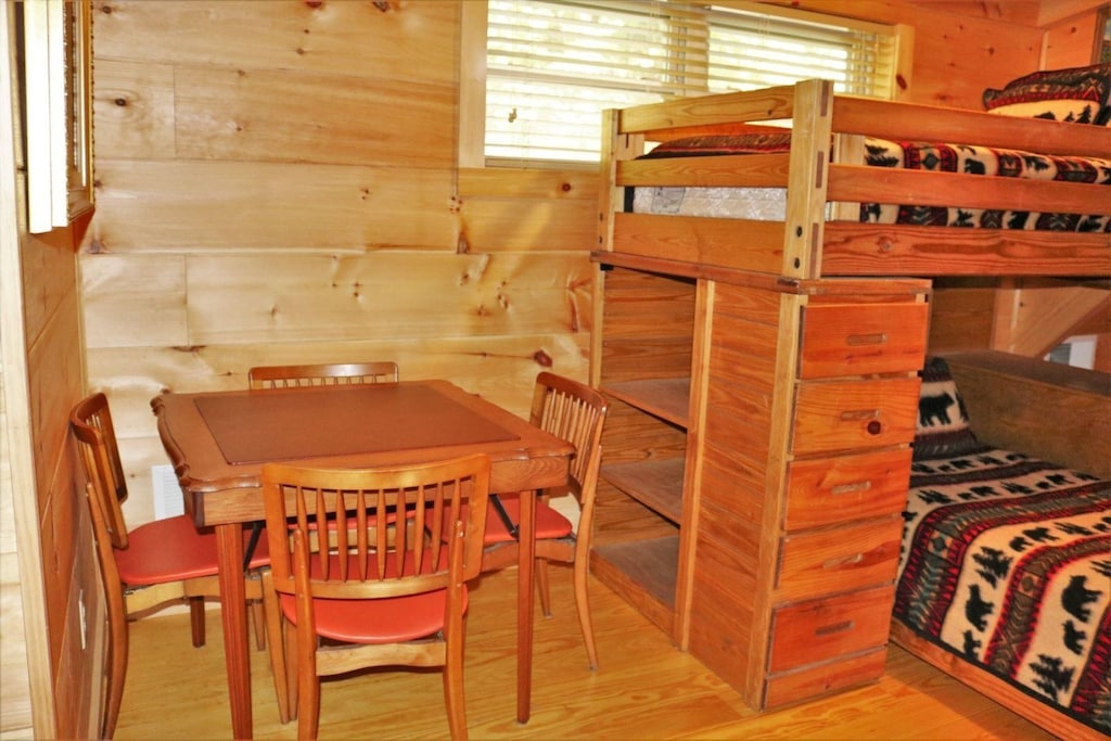 Upper level loft with bunk set and card table