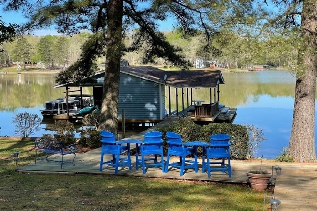 Double boat house for your use, with sitting area and swim platform