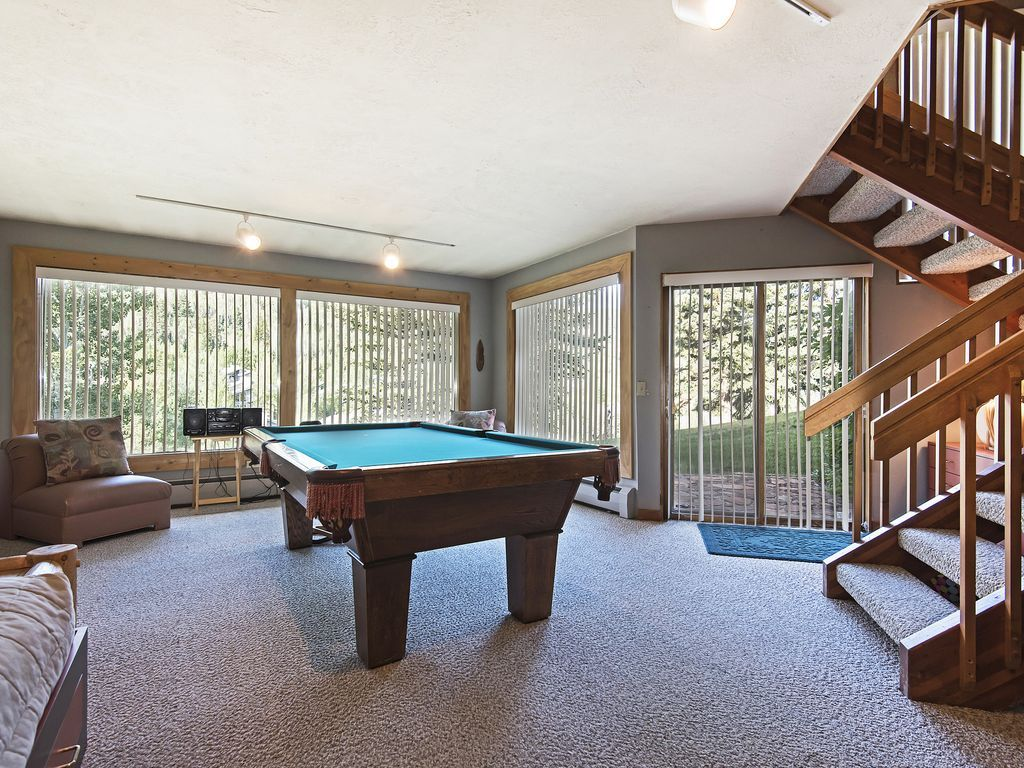 lower level family room with pool table, FlatScreen TV, twin beds