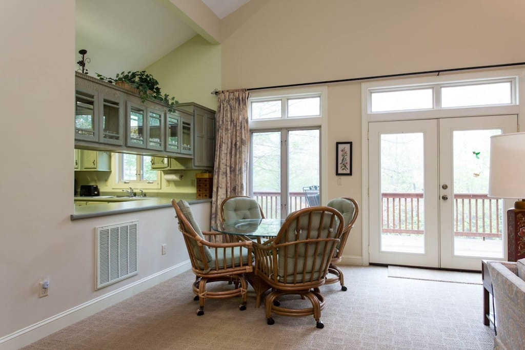 Just past the kitchen is the dining area with a table that seats 4.
