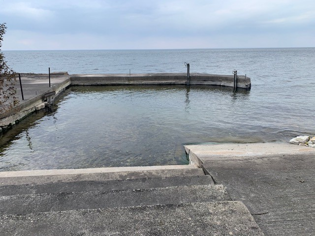 Protected swimming area and kayak launch! Sandy bottom and only a few feet deep! Concrete for safe fishing!