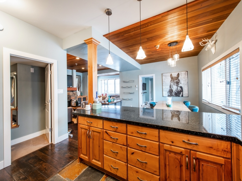 Large central kitchen area.  Well decorated, well stocked home. door to left is bedroom 2, door beside horse is bedroom 3. Far windowed area is kids games area. Living room (fire & TV) to the left of dining area.