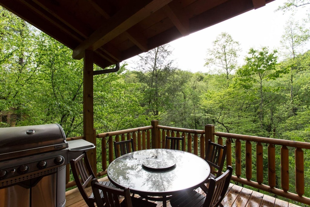 Step out to the deck is a gas grill and dining set that will seat 6.