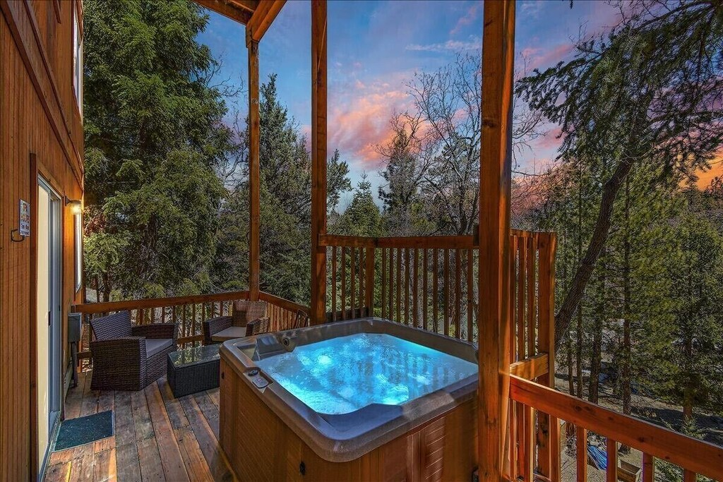 Sit, relax, and enjoy amazing views in private hot tub with seating for 5.