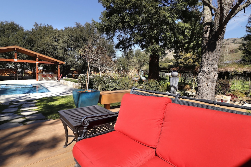 Seating to gardens, outdoor kitchen and pool.