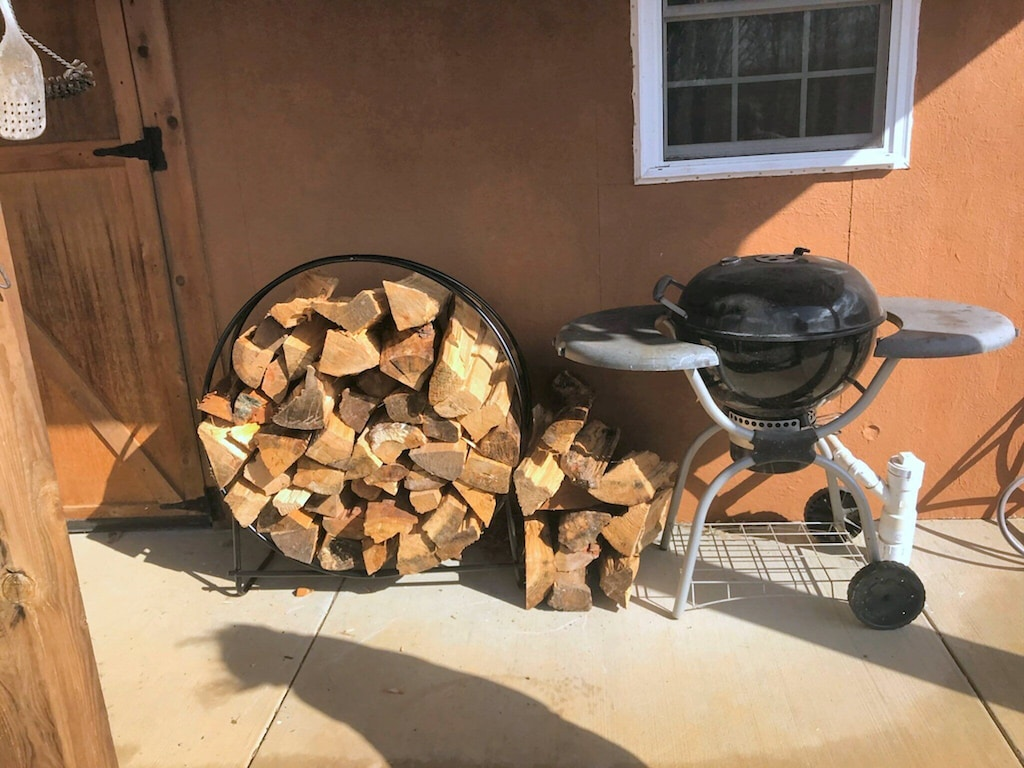 Dried stacked firewood (for a small $10/night fee) and a charcoal grill