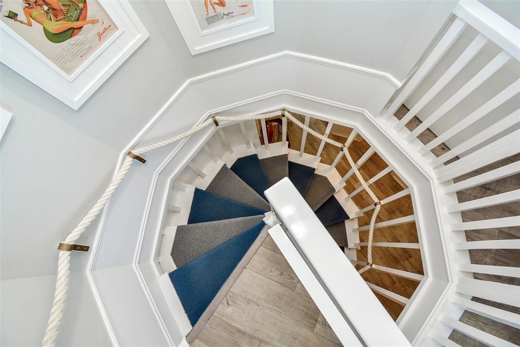 42 of 50 Spiral Stairs - Check out this transition from the Main Level to the Upper Level! Alternating stair tread colors help to delineate the steps