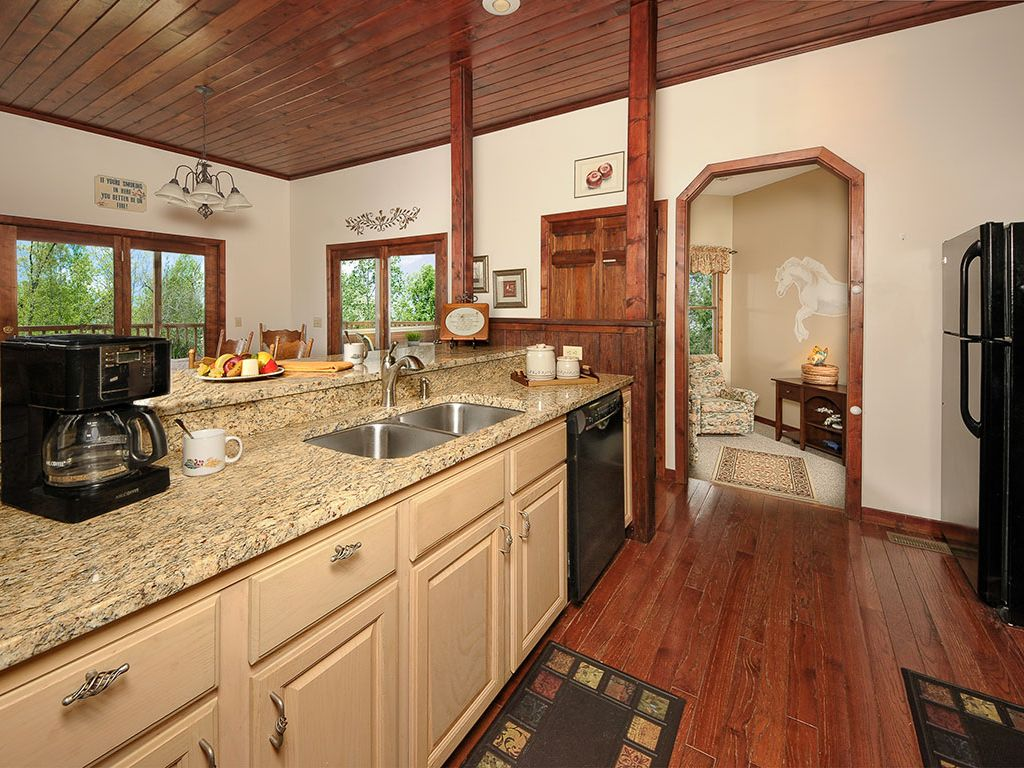 Kitchen with granite counter tops  &  dishwasher. Open to Living /Dining  & den